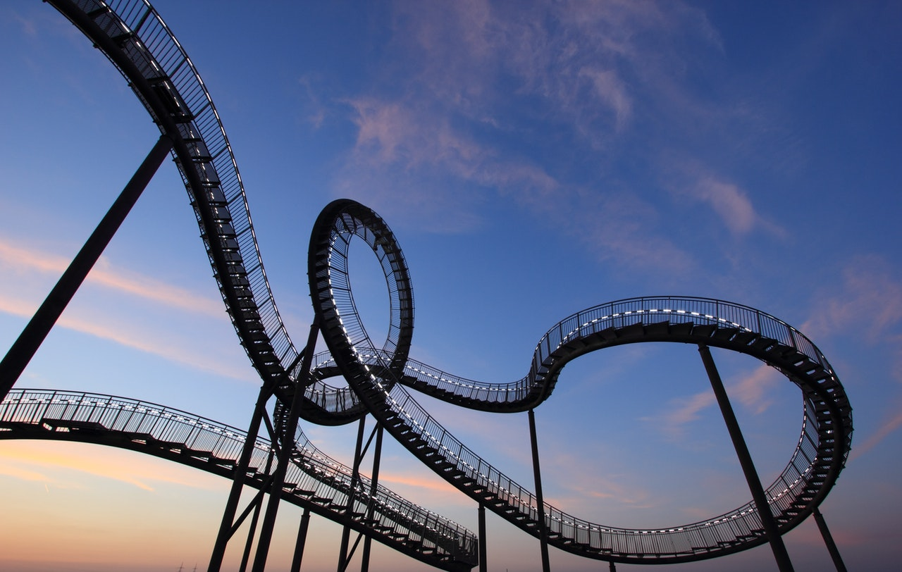 Roller coaster tracks with loops and swirls.